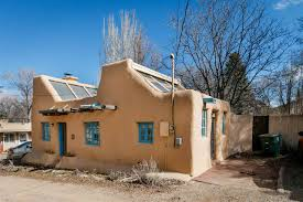 pueblo adobe houses a 1930s pueblo revival style adobe home retrofitted with a rooftop