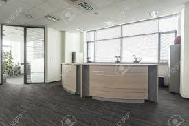 Modern Lobby by Entrance To New Modern Office Interior Reception Stock Photo