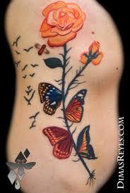 kingdom studio tattoos feminine salvador dali butterflies