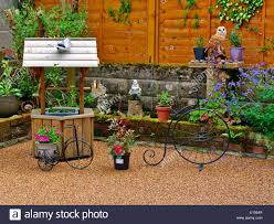 a patio backyard filled with decorative garden ornaments and