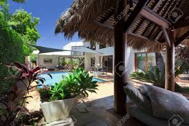 modern backyard with swimming pool and bali hut in australian