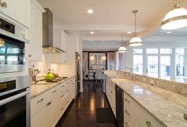 row galley kitchen design with white cabinets and wooden floor