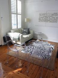 zebra living room set photos hgtv white living room with zebra rug and ghost chairs loversiq