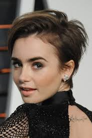 new spring 2015 hairstyles lily collins faith hill rita ora think pixie cuts are freeing