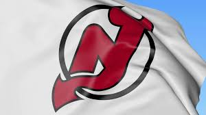 New Jersy Flag Close Up Of Waving Flag With New Jersey Devils Nhl Hockey Team
