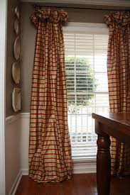 love the curtains the wainscoting and the huge window for the