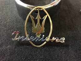 gold maserati logo experience art brass plating