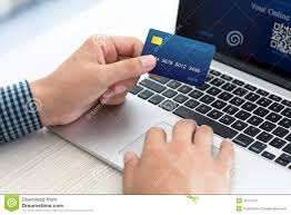 doing shopping with credit card on laptop stock photo
