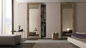 modern wardrobe design in brown with mirror sliding door and
