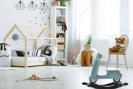 child room white child room with toys bed ls chair and bookcase stock