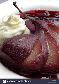 gourmet pears a plate of poached pears in wine with creme fraiche gourmet