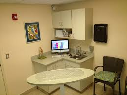 veterinary hospital exam room wall color and cabinet finish also