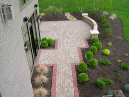 Building A Raised Patio With Retaining Wall by Installing A Paver Patio Embassy Landscape Group Inc