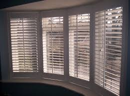bay window shutters in muswell hill provide window treatment for