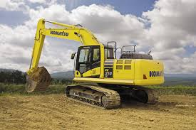 team work at the open pit komatsu excavator cat d11 and cat 773