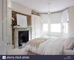 bedroom bedroom with bed fireplace and bay window with roman