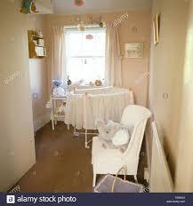 painted wicker chair in baby u0027s nineties nursery bedroom