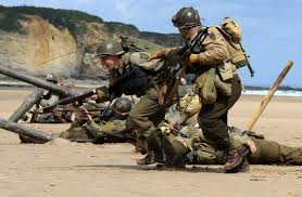 world war ii veterans and re enactors gather in france for the
