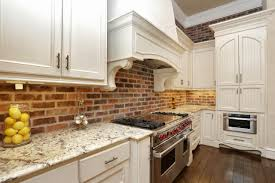 white marble kitchen island exposed brick kitchen splashback kitchen island enveloped by white