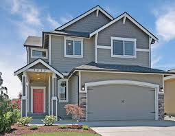 diamond plan grey exterior with white trim black gutters and a