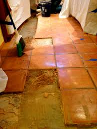 Remove Floor Tiles From Concrete Removal Of Aging And Damaged Saltillo Tile To Refresh The Floors
