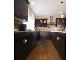 black countertop vaulted ceiling wood walls cathedral beams