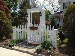 white picket fence garden gate and arbor gardening architecture