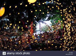 fans walk through a canopy of christmas lights inside the electric