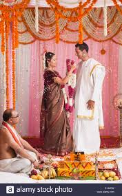 indian wedding garland putting garland to a bridegroom during the south indian