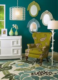 dark teal walls accented by lime green and white jewel like and
