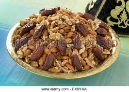 traditional moroccan festive tajine with nuts and dates stock