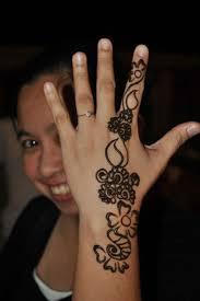 simple henna tattoo on hand