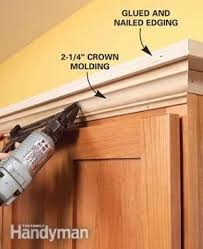 how to add a shelf to a cabinet how to add shelves above kitchen cabinets moldings shelves and