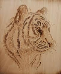 artwork on wood tiger on wood pyrography by bill fugerer