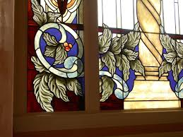 custom stained glass window treatment to enhance the zero lot line