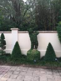Largo Botanical Garden Peeking Wall In Topiary Garden Picture Of Florida