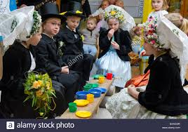 children with traditional sorbian costumes sit together for the