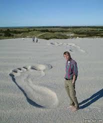 wrestling angel god leaves footprints sand