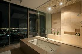 luxury apartment bathroom with cream tiles wall plus fancy jacuzzi