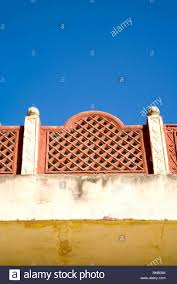 blue sky and roof boundary design village dilwara udaipur