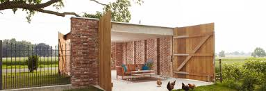 perforated brick garage by wirth architekten doubles as an al perforated brick garage by wirth architekten doubles as an al fresco dining room