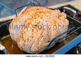 thanksgiving day turkey with spices on the wooden board top