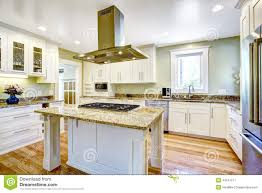 Kitchen Islands Com by Kitchen Island With Built In Stove Granite Top And Hood Stock