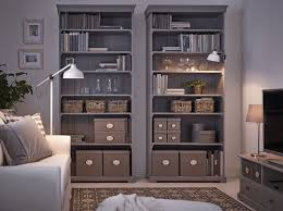 Livingroom Storage by A Living Room With Two Grey Ikea Hemnes Bookcases Filled With