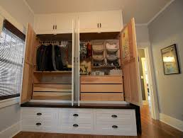 traditional closet with built in bookshelf hardwood floors in