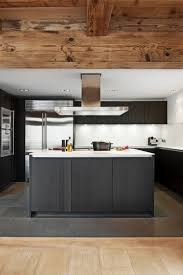 a central island features a large worktop with an integrated
