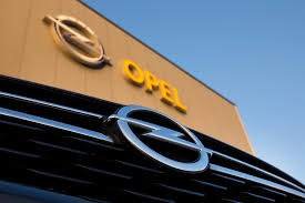 opel yellow gm strikes a deal to sell opel to french automaker psa fortune