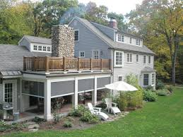 new houses being built with classic new england style retractable screens at classic new england farmhouse traditional