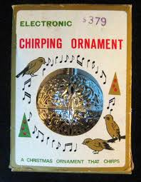 electronic chirping ornaments flipping a dollar