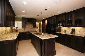 marble countertops dark brown cabinets kitchen lighting flooring
